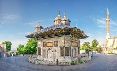 Istambul, Turkey – 07.13.2019. Fountain of Sultan Ahmet behind the gates of Topkapi in Istanbul, Turkey, on a sunny summer day.