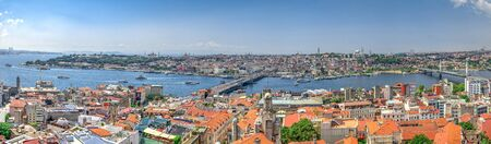 Istambul, Turkey – 07.13.2019. Big panoramic top view of Eminonu district of Istanbul with Galata and Ataturk bridges on a summer day