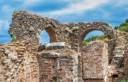 Ruins of Scholastica Bath in antique Ephesus city on a sunny summer day Stock Photo