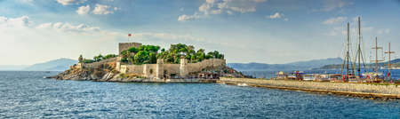 Kusadasi, Turkey – 07.18.2019. Kusadasi castle in Turkey and pleasure boat parking on a summer evening Editorial