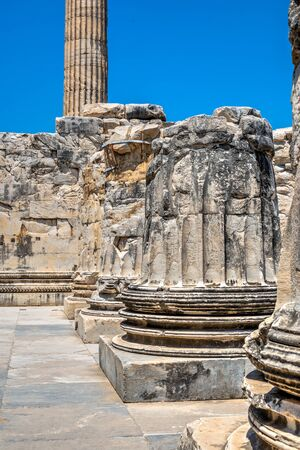 A base of a column of the eastern facade of the Temple of Apollo at Didyma, Turkey, on a sunny summer day