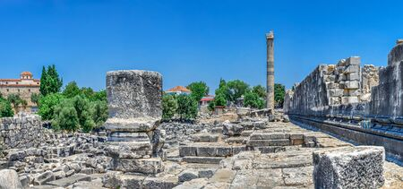 The northern flank of the temple of Apollo with the stadium at Didyma, Turkey, on a sunny summer day