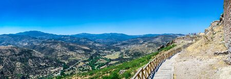Ruins of the Ancient Greek city Pergamon in Turkey on a sunny summer day. Big size panoramic view Imagens