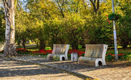Odessa, Ukraine 11.05.2019. Artistically designed street benches in Shevchenko Park in Odessa, Ukraine, on a sunny autumn day