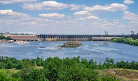 Zaporozhye, Ukraine 07.20.2020. Panoramic view of the Dnieper hydroelectric power station from the Khortytsya island in Zaporozhye, Ukraine, on a sunny summer day Редакционное