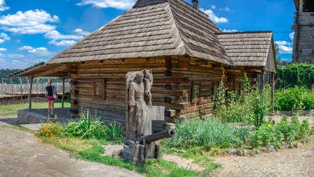 Zaporozhye, Ukraine 07.20.2020. Traditional Ukrainian hut in the National Reserve Khortytsia in Zaporozhye, Ukraine, on a sunny summer day Редакционное