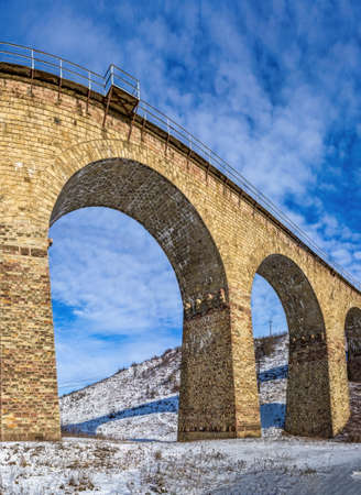 Plebanivka, Ukraine 06/01/2020. Viaduct in Plebanivka village, Terebovlyanskiy district of Ukraine, on a sunny winter day