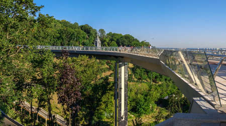 Kyiv, Ukraine 07.11. Pedestrian glass bridge in Kyiv, Ukraine, on a sunny summer morning Editoriali