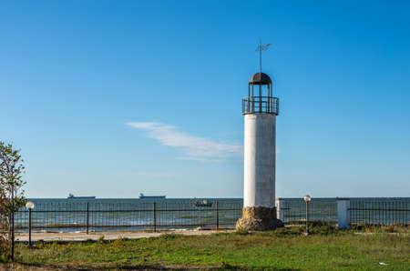 Old Lighthouse Karabush in the resort village of Morskoe near Odessa, Ukraine, on a sunny spring day