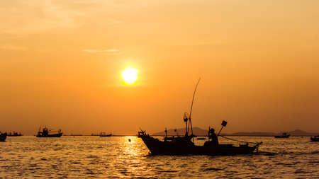 Sea, Sunset and Fisherman
