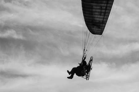 The man riding paramotor in the sky Stock Photo