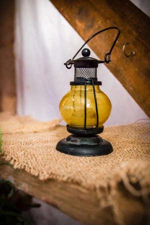 Vintage lantern on old wood shelve