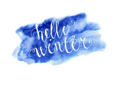 hand written: Vector hand written inscription Hello winter. Bright blue hand drawn watercolor texture and white hand written words. Calligraphic phrase.