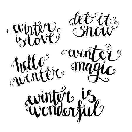 Set of hand written words about winter. Hand lettering isolated on white background. Winter is love. Let it snow. Hello winter. Winter magic. Winter is wonderful.