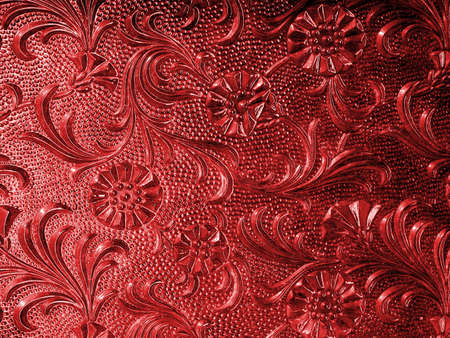 Vintage glass with floral pattern in red