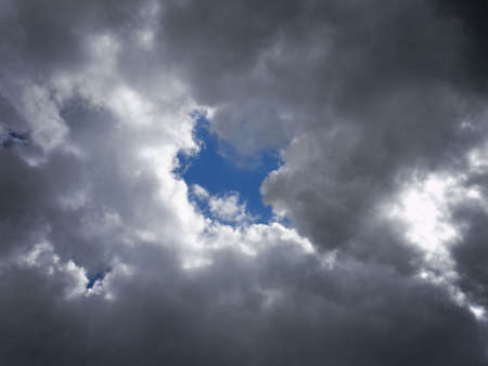 Little blue sky behind the grey storm clouds                                photo