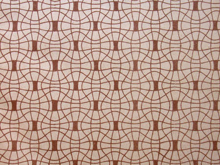 Used vintage wallpaper with tildes, pattern in brown, 1920s Stock Photo