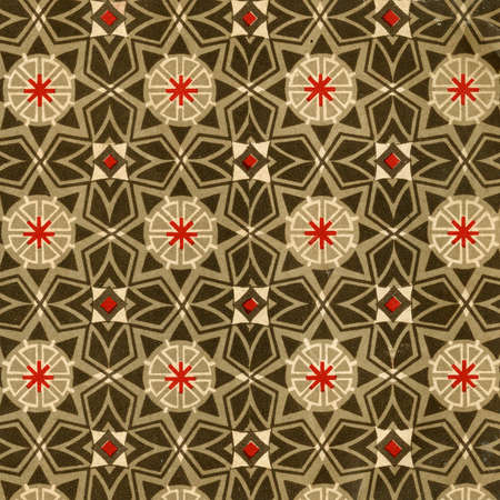 Used vintage wallpaper with stars and other geometric elements - natural grainy surface photo
