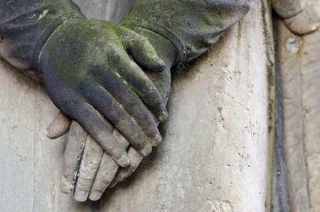 Clasped hands - statue of an angel at old cemetery, Krasna Lipa, Czech republic, Europe Reklamní fotografie