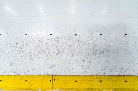 Hockey rink boards with scratched and damaged surface Banque d'images