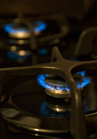 gas flame: gas flame burning on a black tile