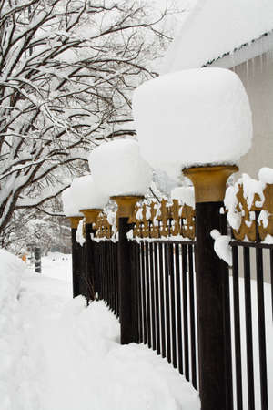 frost bound: pillars of the gate under the caps of snow Stock Photo