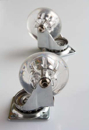 furniture hardware: two castorls for furniture on a light background