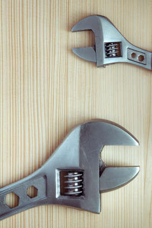 alligator wrench: two adjustable wrenches large and small on a wooden surface Stock Photo