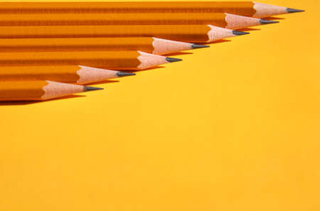 sharpened: sharpened pencils on a yellow background Stock Photo