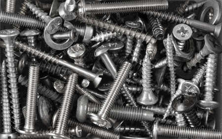 metal screws, bolts, nuts monochrome background Stock Photo