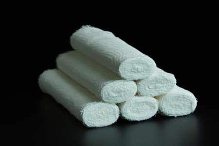 white bandage: Medical white bandage rolls on a black background Stock Photo