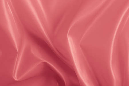 organza: large folds on the  pearly pink fabric, abstract background