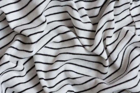 tricot: wrinkled knitted fabric in black and white stripes Stock Photo