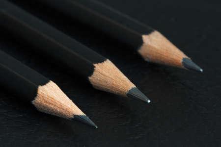 grafit: Three graphite pencils on a black background