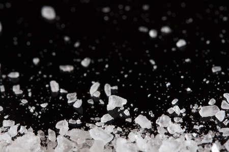 sea salt crystals on the black background