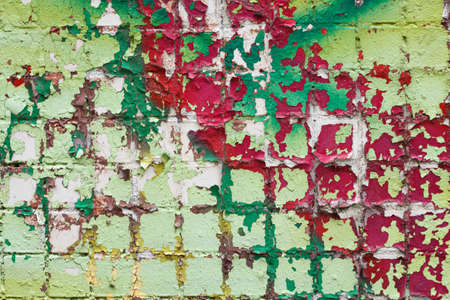ageing: texture of a wall with cracked dye of different colors