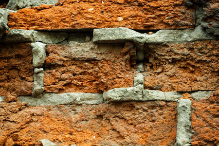 coarse: wall fragment from an old coarse red brick,  texture Stock Photo