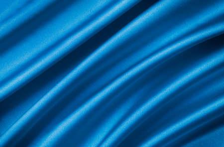 blue satin: drape a bright  blue satin fabric
