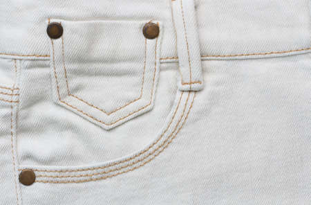 trousers: close up detail of white denim trousers