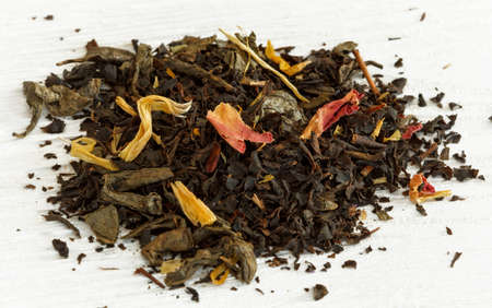 admixture: composition  large leaf  tea with the petals of calendula, tea rose and fruit pieces Stock Photo