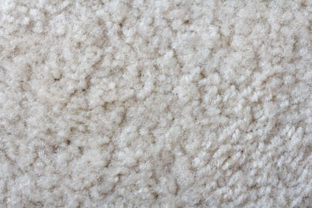 synthetic fiber: surface of synthetic beige carpet texture Stock Photo