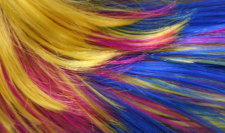 peruke: wig of synthetic hair with colored  strands  for carnival as background Stock Photo