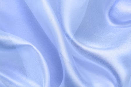 blue  transparent fabric with large folds,  abstract background