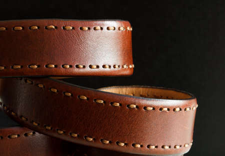 Mens leather belt on a black background Stock Photo