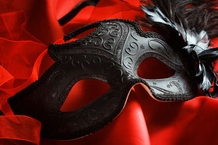 Carnival venetian mask on a bright red background Stock Photo