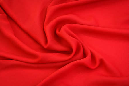 red fabric with large folds