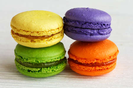 colorful macaroons with bright dyes on a white surface 스톡 콘텐츠