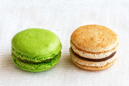 macaroons with bright colorful dyes and without them, concept of choosing healthy food