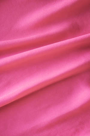 delicate pink fabric with large folds,  abstract background