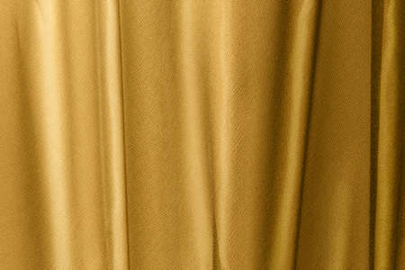 drapery of golden fabric with large folds for background